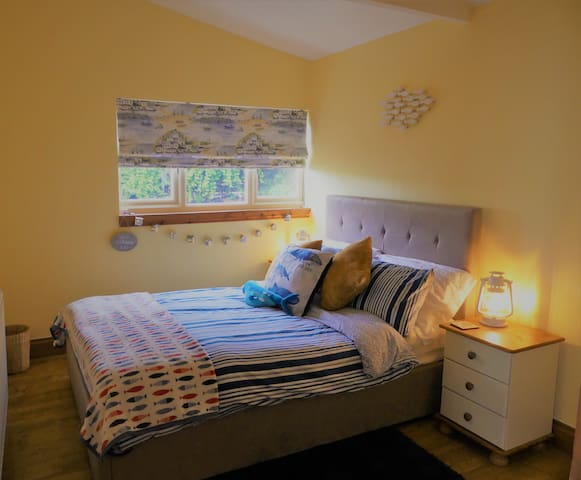 Large double bedroom with views of the garden.
