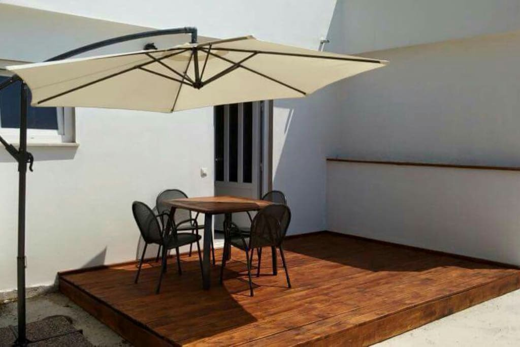 Studio apartment terrace with table and chairs