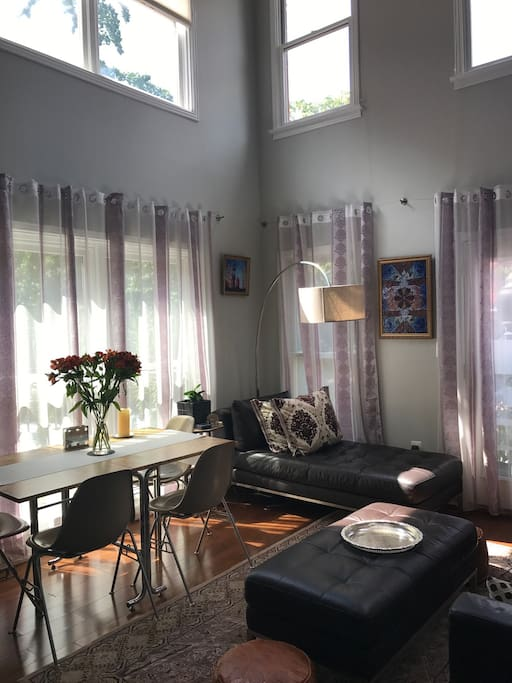 living/dining room with two story windows and great light