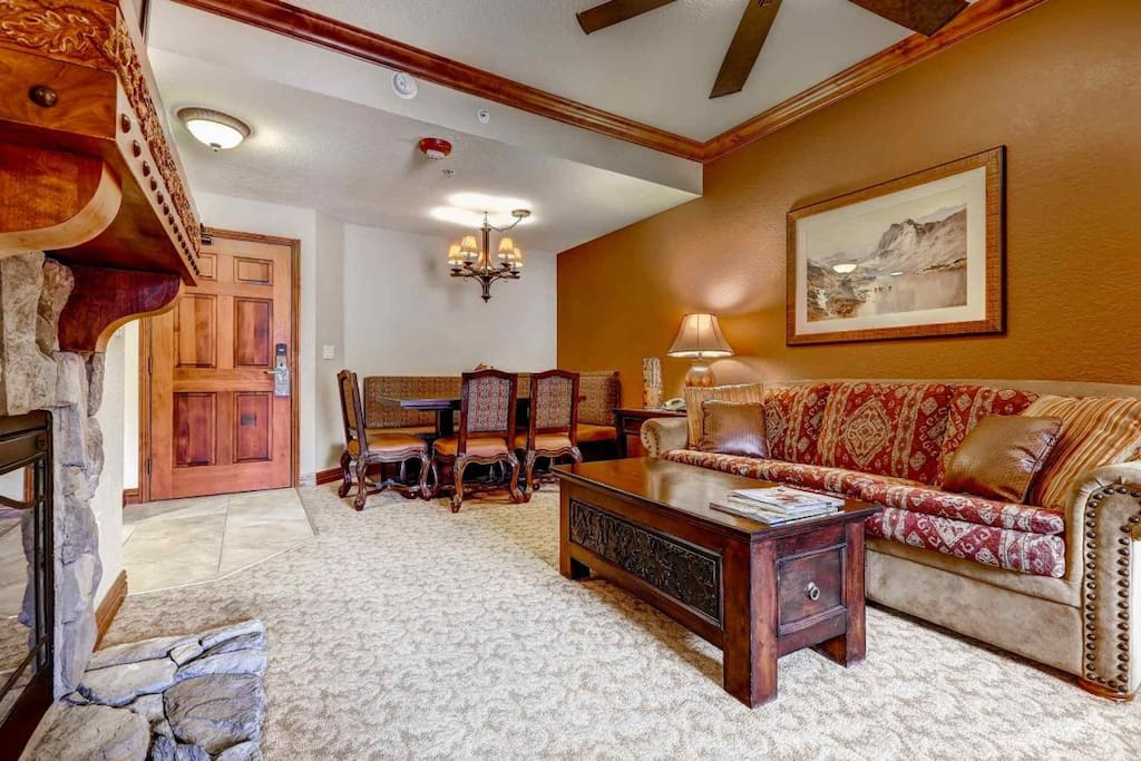 A large living room with fireplace, HDTV, queen sofa bed; flows nicely into the formal dining area.