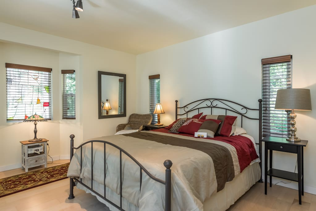 The super large bedroom has stained glass, a desk and radiant heat in the floors.