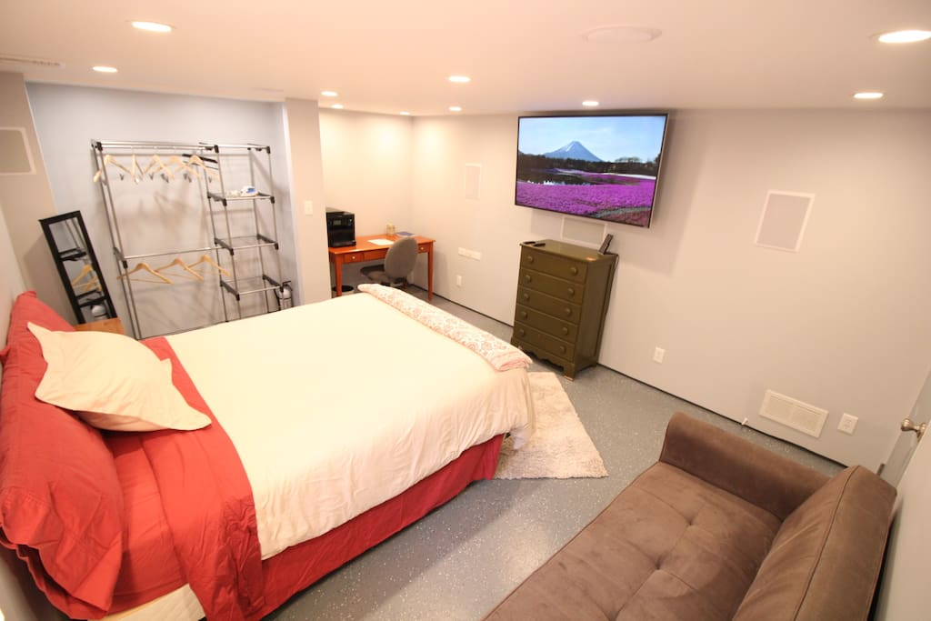 Full view of bedroom with closet/storage area in the back left.