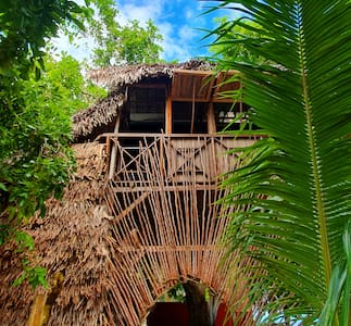 Tree house on the beach sea view
