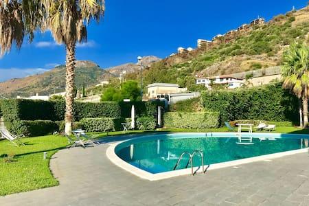 Solarium, pool and beach in Taormina/ Letojanni