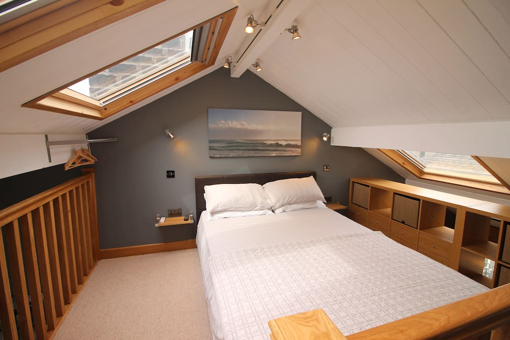 Airy open plan mezzanine bedroom