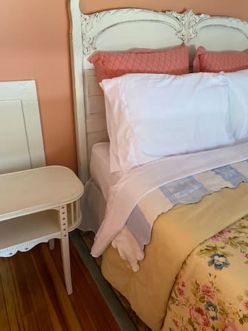 Full sized bed in guest room.