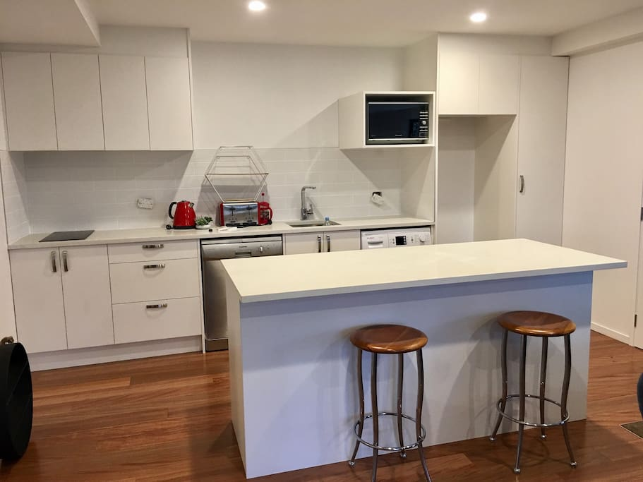 Spacious and well equipt kitchen with breakfast bar (NB photos taken before totally finished!)