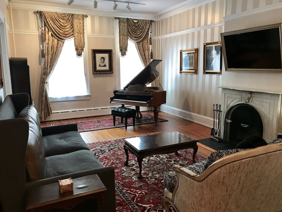 The living room is furnished with high end new furniture or antiques. The artwork was formerly hung in congressional buildings.