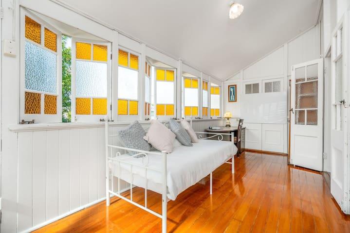 Sun room has a single bed.