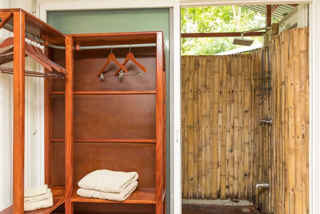 Your private out door shower. 24hr hot water and fresh towels. Space to store your clothes.
