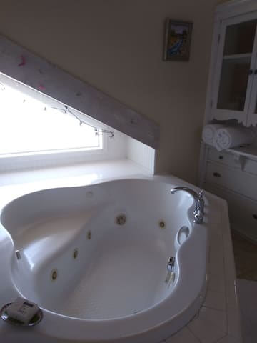 Large Private  suite with heated 2 person Jacuzzi