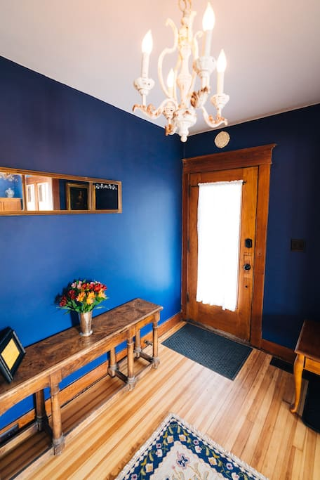The entryway is spacious and features an armoire for your coats