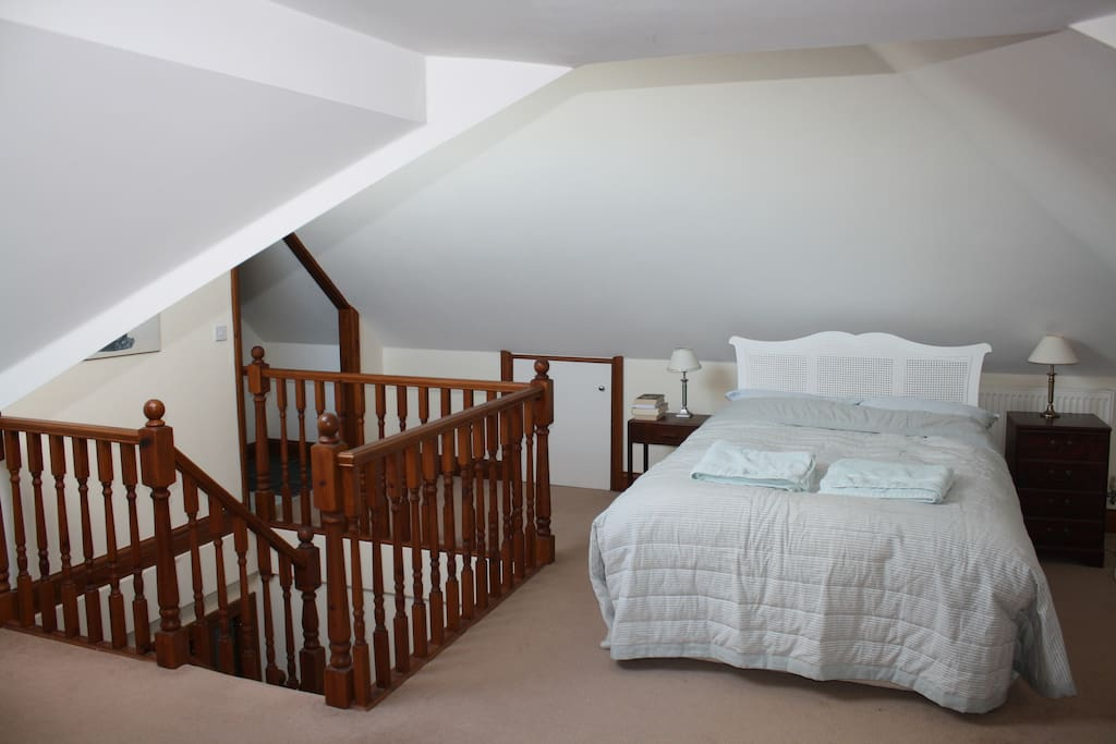 The bedroom is open plan to the stairs but there is a door at the bottom to keep your space private.