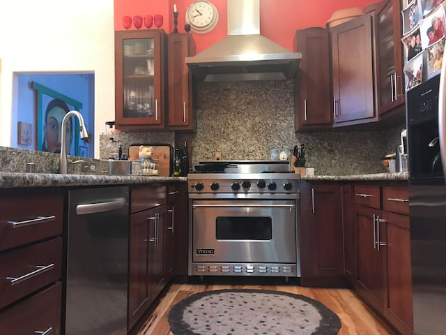 Kitchen with awesome stove and eat-in dining area.