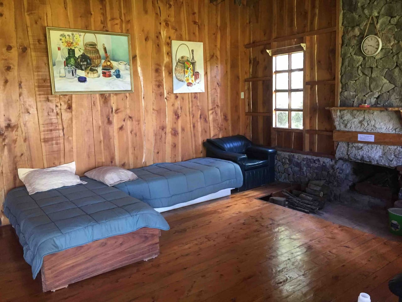 Living room. You can also place a mattress on floor and sleep in front of the chimney