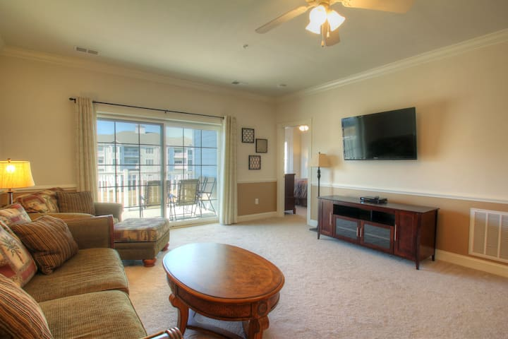 Beautiful lake view condo offers outdoor pool!