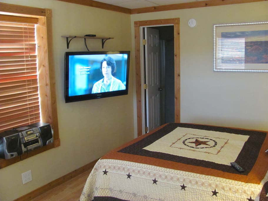 Large 40 inch wall mounted TV with Cable TV.  Wifi also provided.