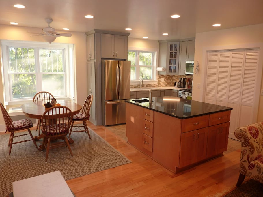 Open floor-plan kitchen/dining/living