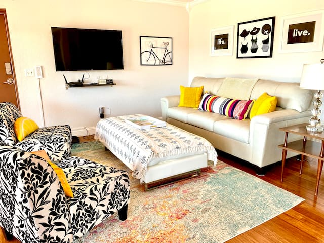 Bright and cozy livingroom area with streaming TV