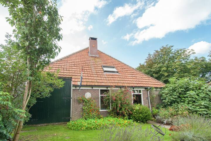 This authentic West Friesian farmhouse is located in Callantsoog, North Holland.