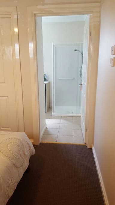 The ensuite is accessible from the main bedroom