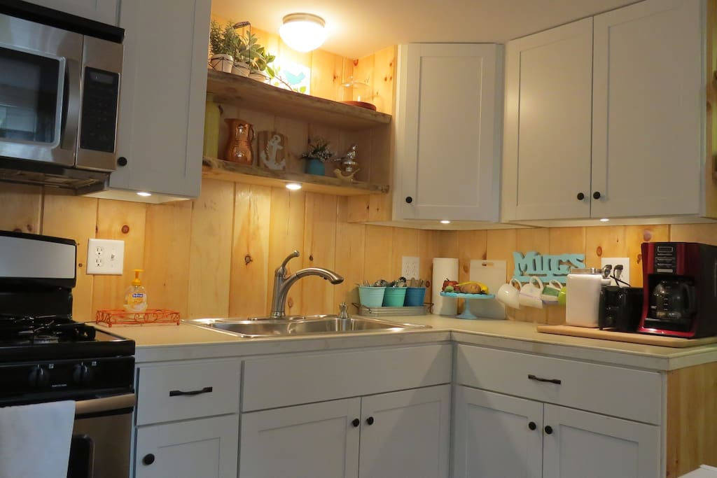 The kitchen is the heart of our total renovation, with all new cabinets, appliances and fixtures.