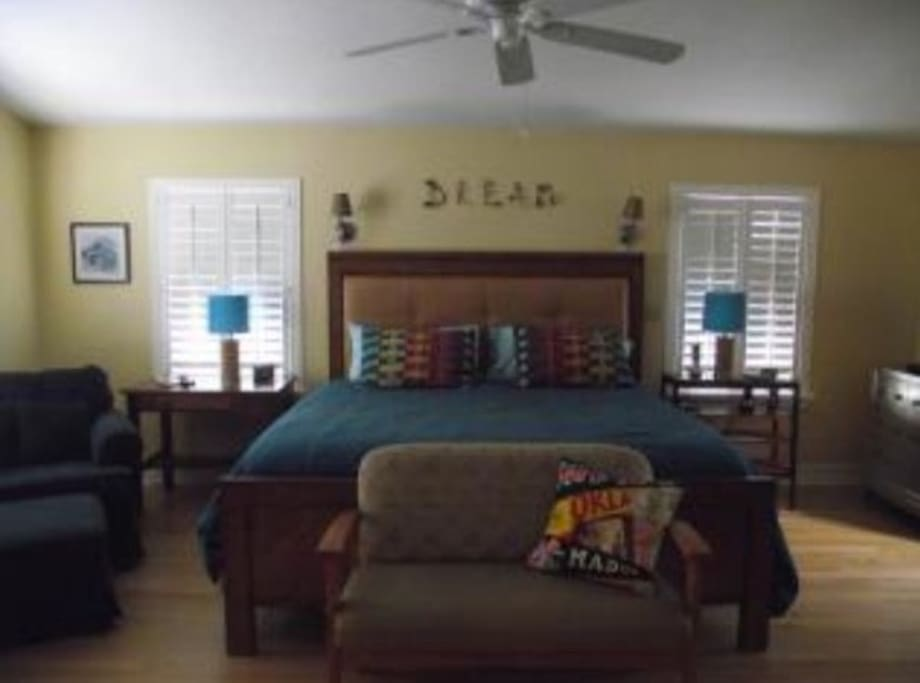 master suite with master bathroom, soaker tub, double futon located conveniently in the attached study