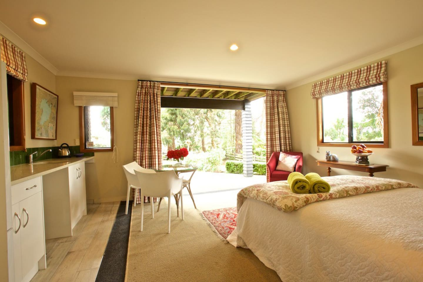 Sunny main room, throw open the doors and look down to the lake and across The Glade