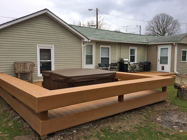 Beautiful newly built composite deck is a perfect place to hang out and enjoy coffee in the morning, grill out in the afternoon or the fire pit in the evening.