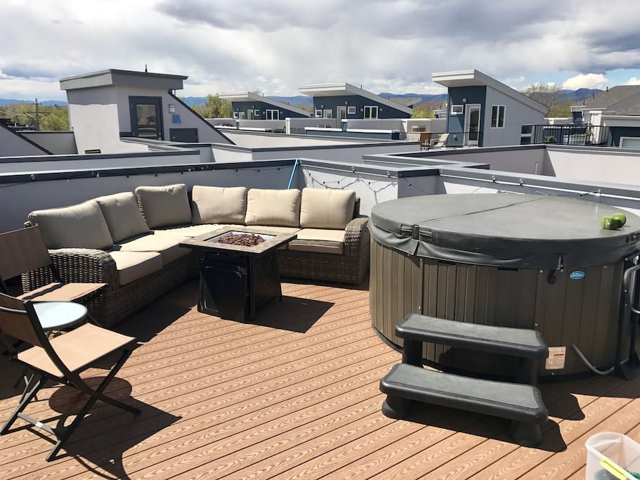 Rooftop deck with fireplace and hot tub