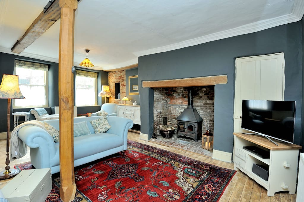 The cosy living room with its huge fireplace