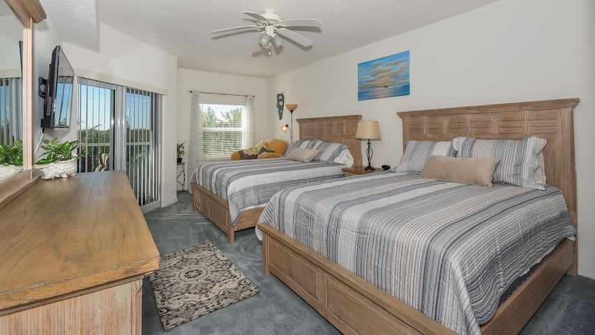 Master bedroom with 2 queen beds and chaise. Has flat screen tv with cable.