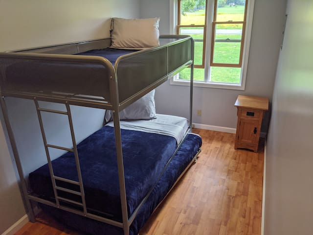 Second bedroom has twin bunk bed with trundle bed.