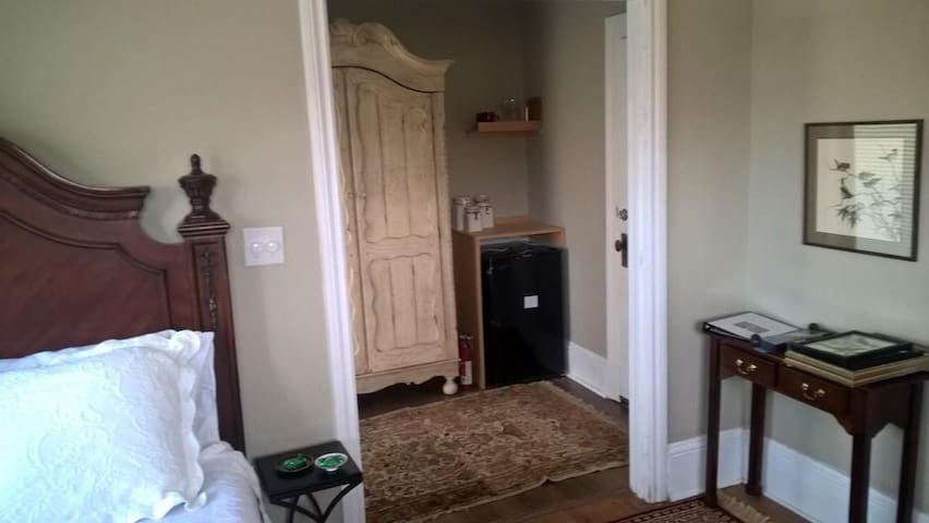 Private entrance with armoire, mini refrigerator and coffee maker.