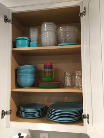 Plates, bowls, kids dishes, and storage containers.