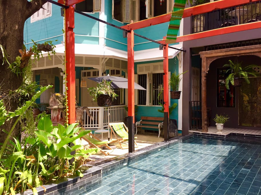 your private plunge pool in bangkok, on a sunny day, lounge lazily around the pool.