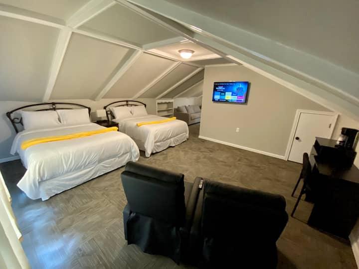 Banana Split Suite (2 Queens, Sofa, Private Bath)