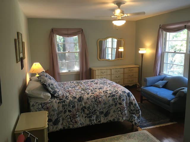 """You are in the largest sleeping accommodations when enjoying the upstairs """"French Provincial bedroom"""""""