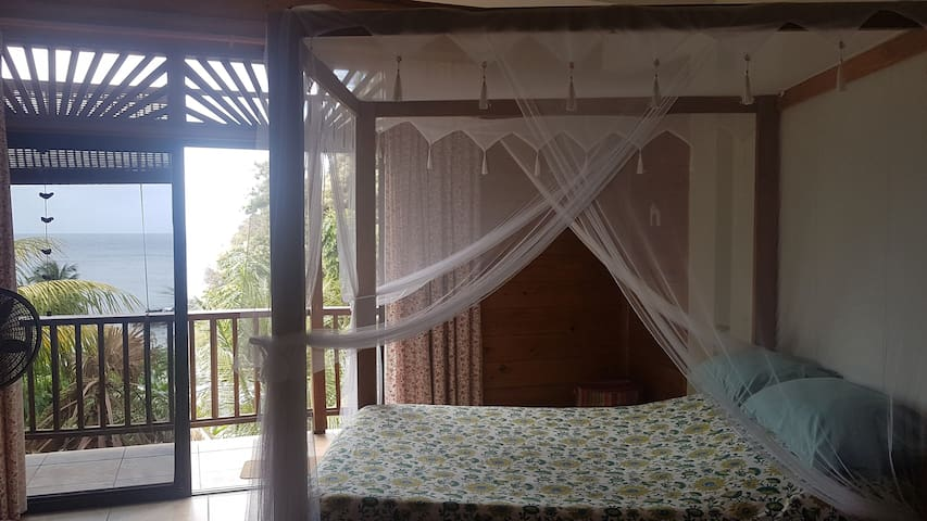 Main bedroom with seaview from the bed.  Mosquito screen.