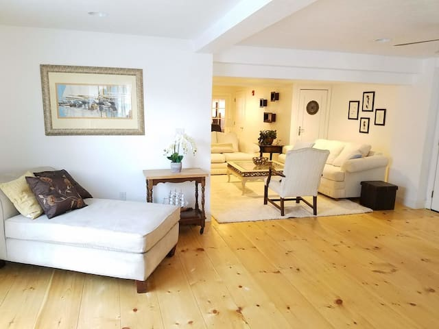 Spacious an Bright Living Room with New Pine Floors