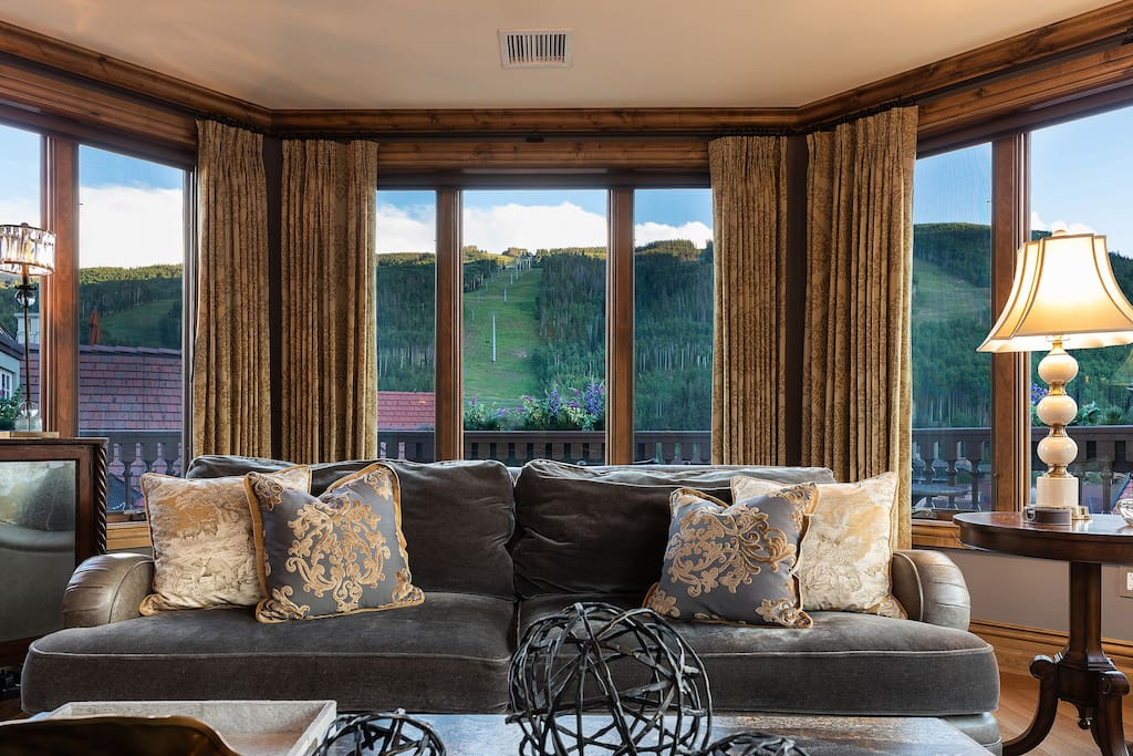 Chic, open living spaces with rich wood accents and gorgeous views.
