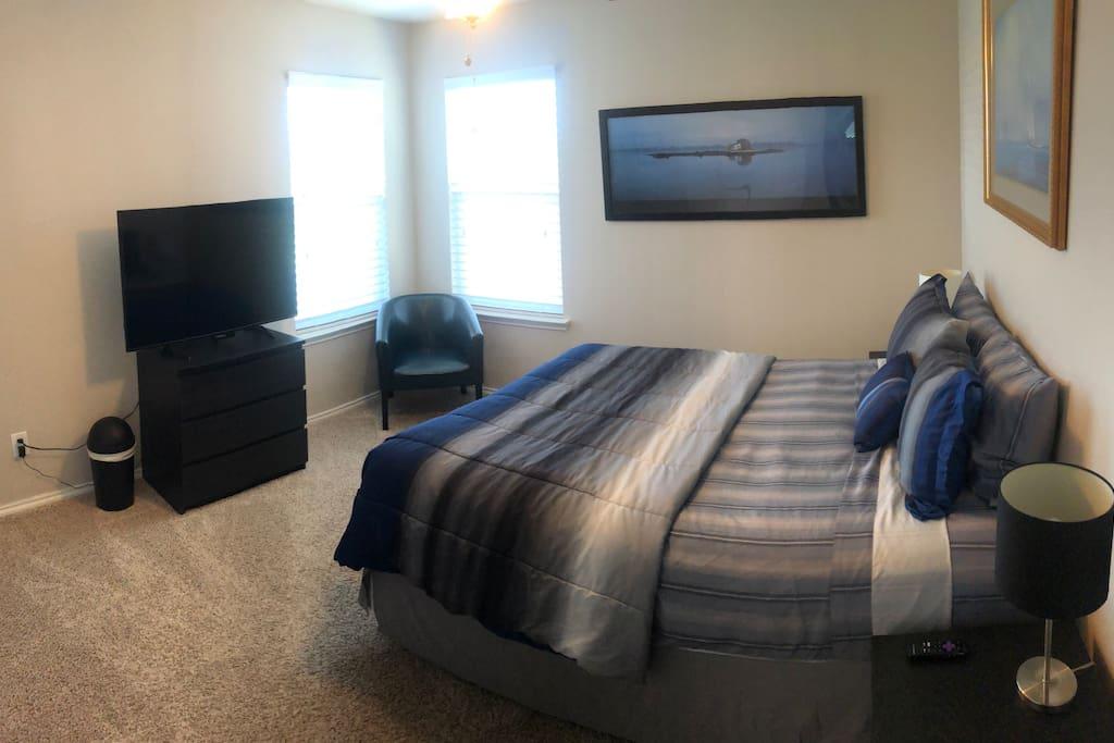 """Bedroom 1 (Blue Room) with 50"""" smart Roku TV."""