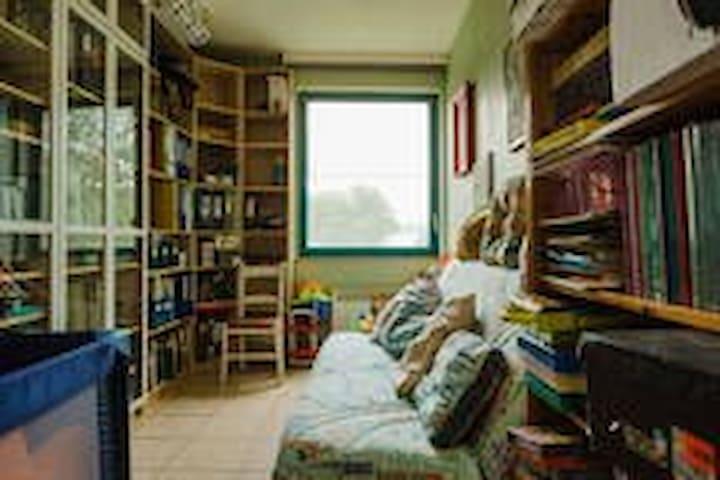 la chambre en location avec canape-lit