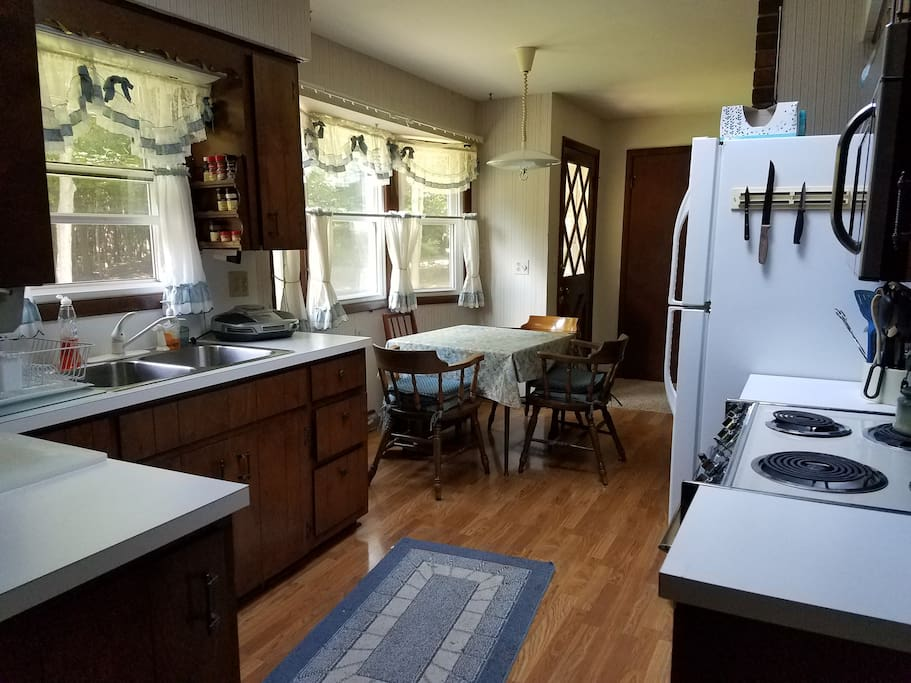 The kitchen is fully appointed with dishes, pots, pans, oven, stove, microwave -- everything you would expect in a summer cottage.