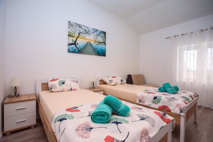 Bedroom No.3 with two single beds 90x200 and sofa suitable for one person, air conditioning and amazing view.