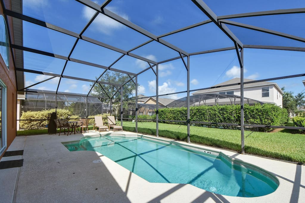 Relax in the shimmering waters of your own private pool in this screened enclosure - where you can really relax on your next vacation to Orlando.