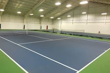 indoor tennis court located in clubhouse