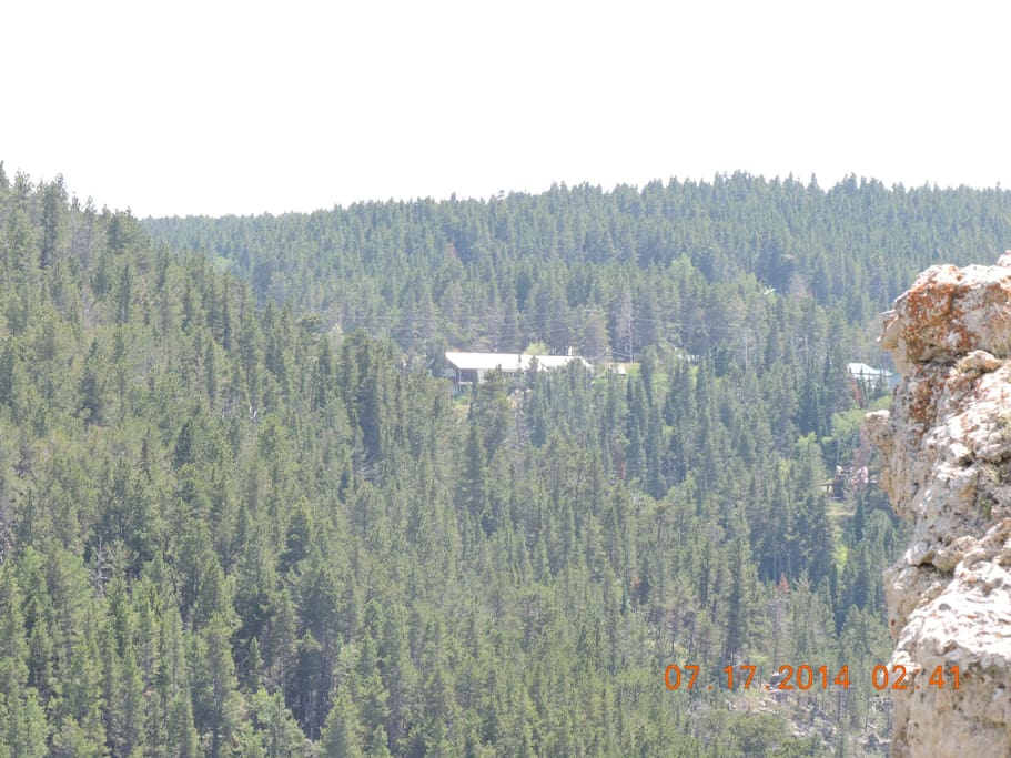 View of House from across canyon  ie from pic one to house