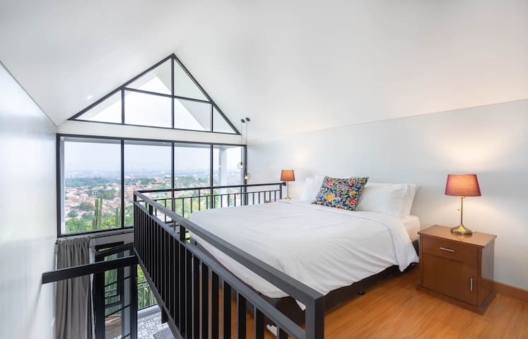 Breathtaking views from the mezzanine level bedroom.