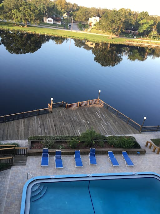 View of pool deck and river from balcony